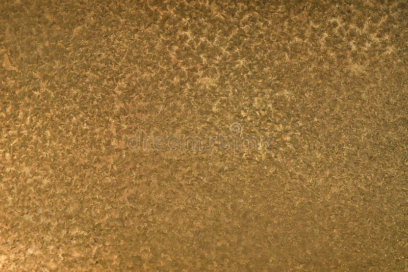 Fondo de la textura del oro modelos en la superficie de metal foto de archivo libre de regalías
