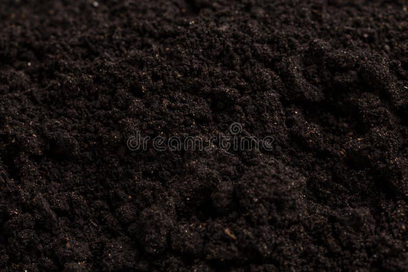 Fondo de la textura del suelo Tierra negra foto de archivo libre de regalías