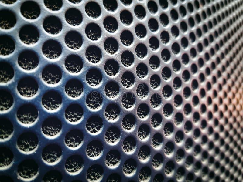 Fondo de la textura perforada del altavoz de audio fotografía de archivo libre de regalías