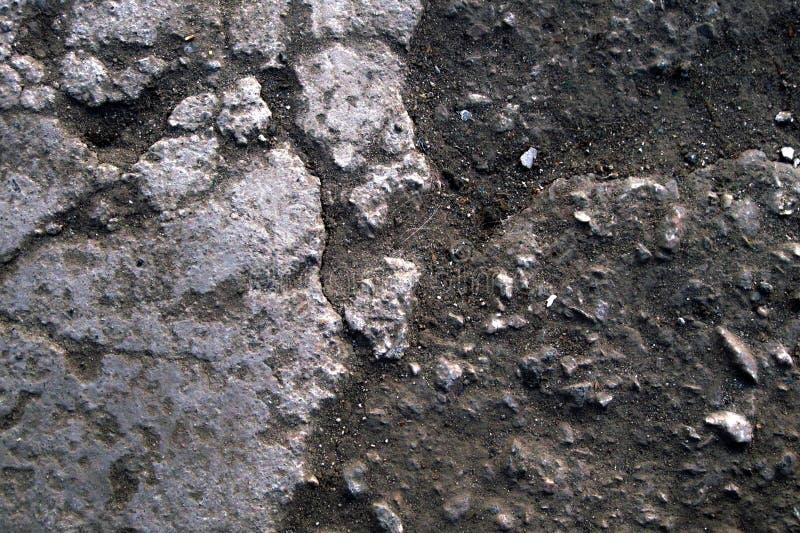 Fondo de la textura de la piedra y del suelo con polvo y partículas granulares Cierre para arriba la macro del terreno rústico foto de archivo