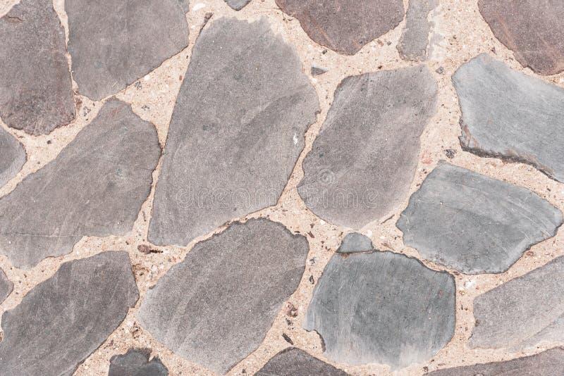 Fondo de la textura superficial de piedra gris Camino viejo hecho de piedra natural visi?n superior, horizontal imagen de archivo libre de regalías