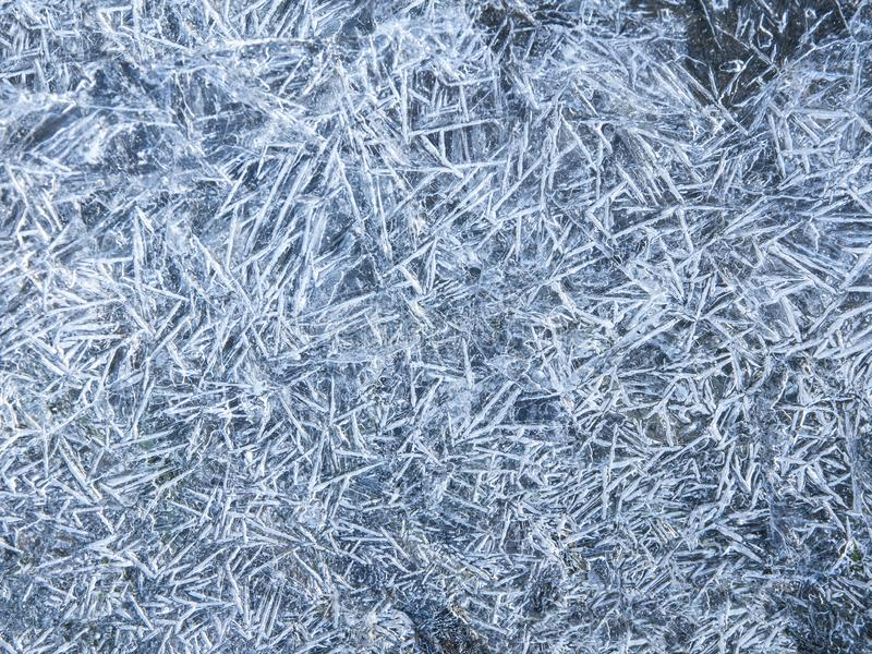 Fondo de la textura de la tierra congelada Fondo del suelo y de la nieve fotos de archivo