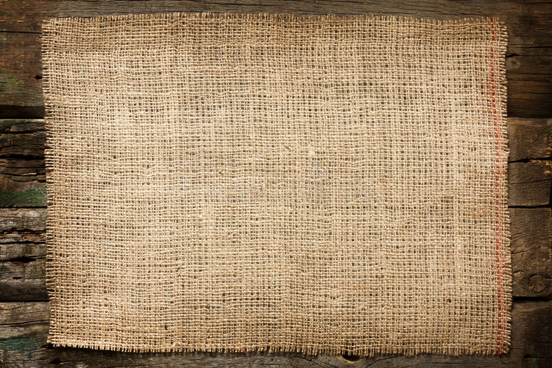 Fondo de la vendimia de la lona del yute de la arpillera fotografía de archivo
