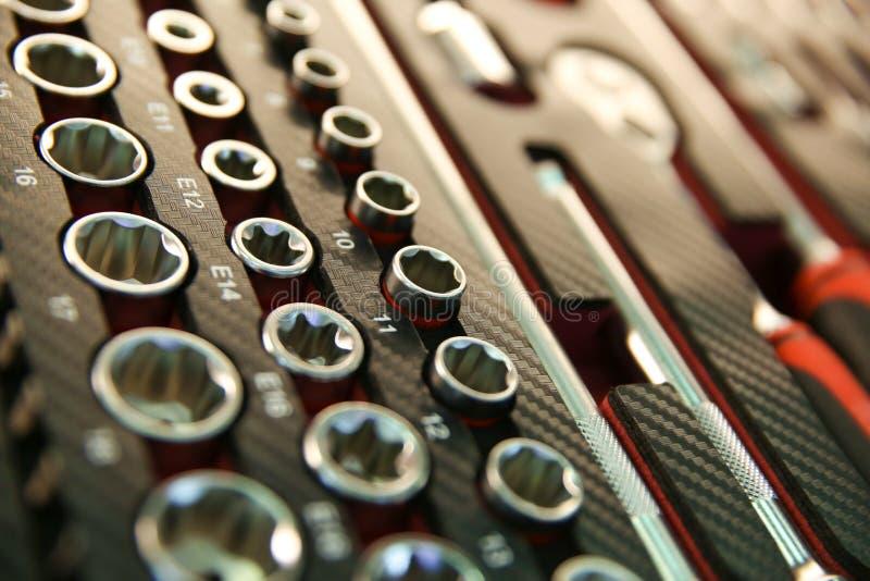 Fondo de las llaves de zócalo en caja de herramientas del carbono imagen de archivo