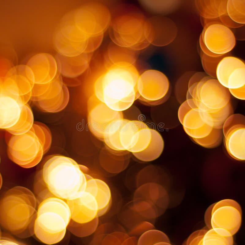 Fondo de las luces de la Navidad del oro fotografía de archivo