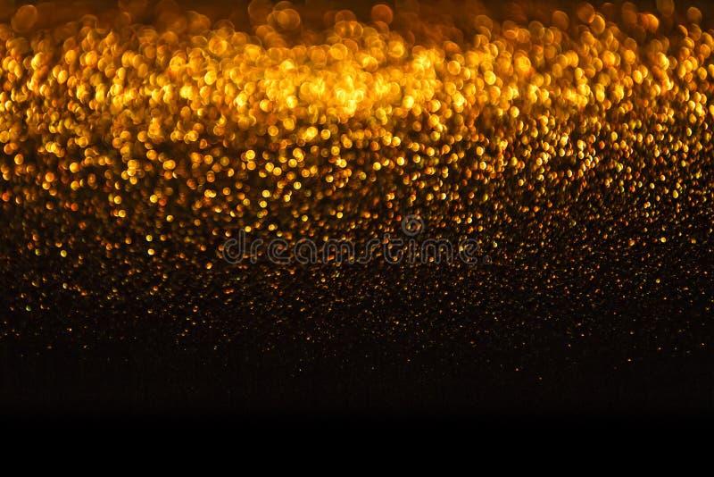 Fondo de las luces, luz abstracta del día de fiesta de la falta de definición del oro, de oro foto de archivo