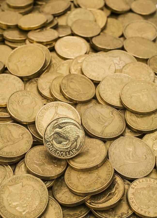 Fondo de las monedas de oro de Nueva Zelanda fotografía de archivo