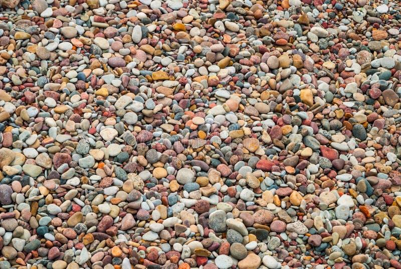 Fondo de las piedras del guijarro en la playa, textura imagenes de archivo