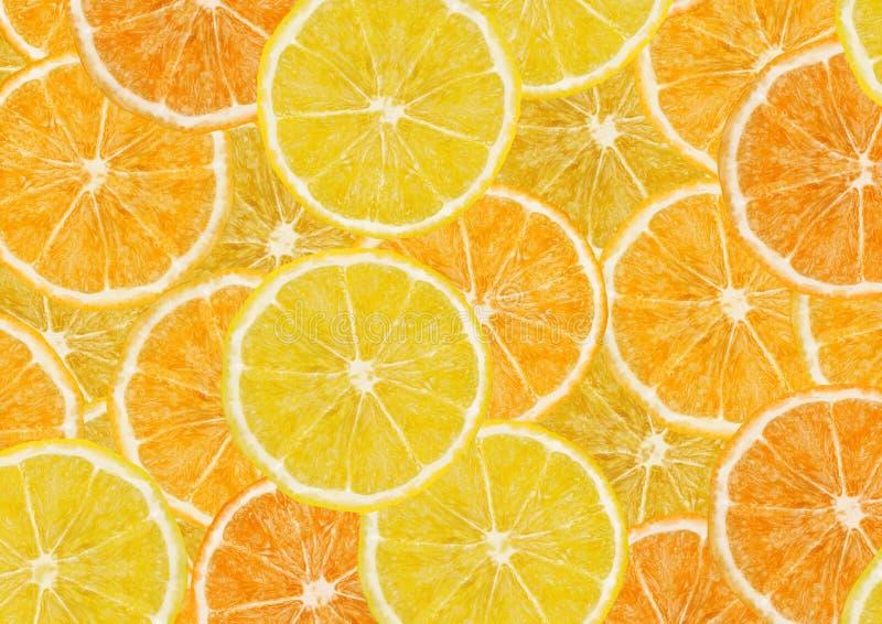 Fondo de las rebanadas de los limones y de las naranjas imagenes de archivo
