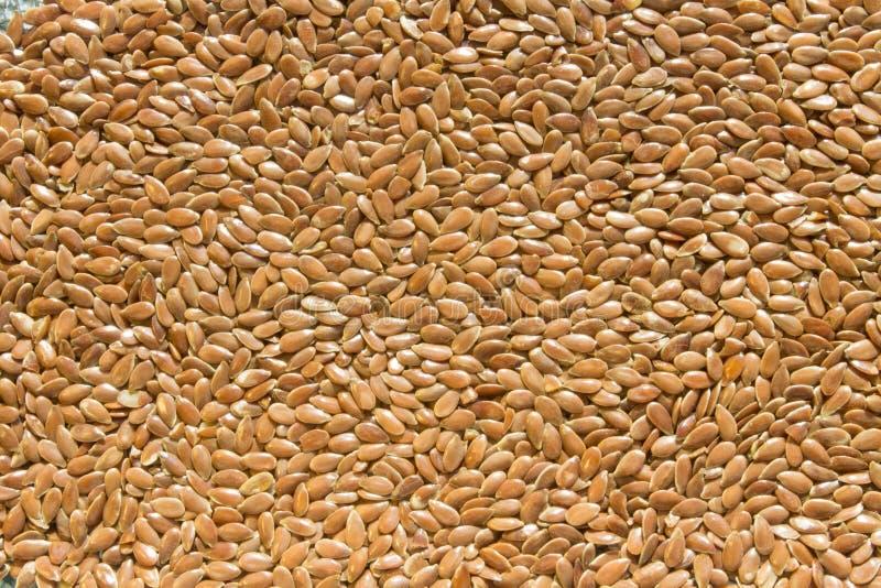 Fondo de las semillas de lino crudas secas marrones brillantes foto de archivo