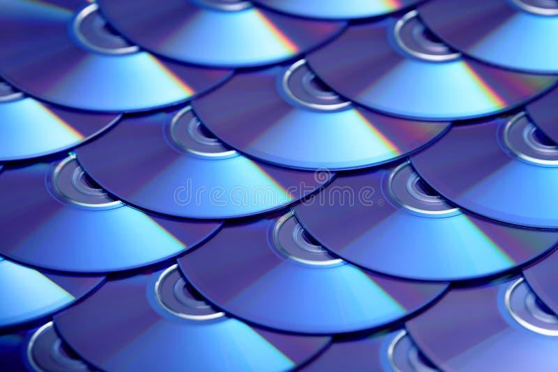 Fondo de los compact-disc Varios discos blu-ray cd del DVD Almacenamiento de datos digitales registrable o reescribible óptico foto de archivo libre de regalías