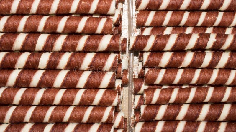 Fondo de los túbulos de la oblea con el chocolate imagenes de archivo