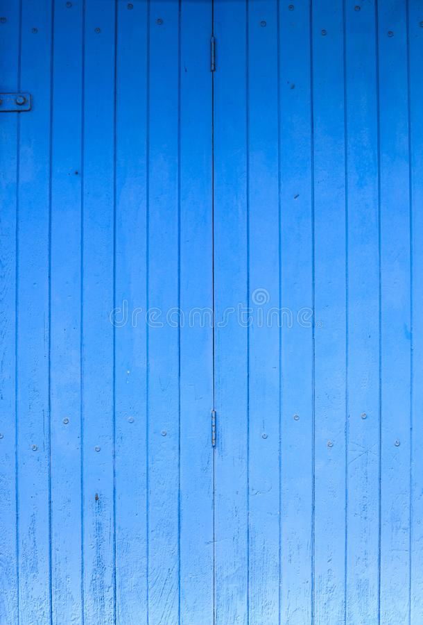 Fondo de madera áspero pintado coloreado azul del tablero del panel de la cerca, del piso o de pared Hogar arquitectónico de la c imagen de archivo libre de regalías
