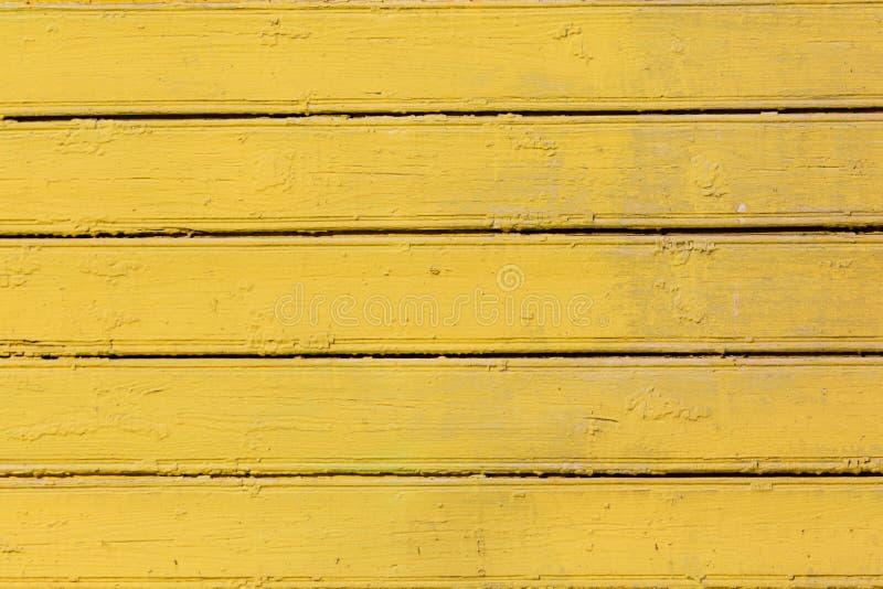 Fondo de madera coloreado amarillo Fondo abstracto rasguñado de madera fotografía de archivo