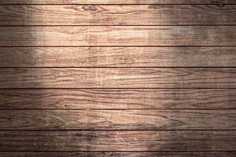Fondo de madera con el punto de la luz del sol fotografía de archivo