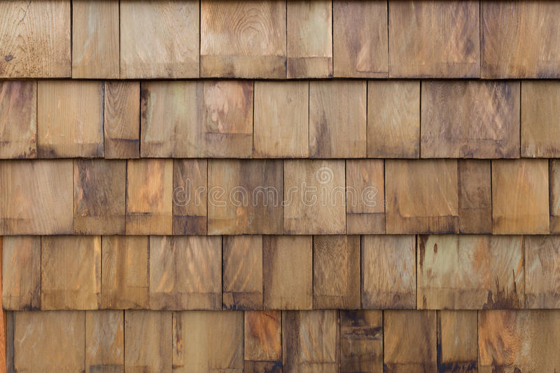 Fondo de madera de la pared del panel de la teja de la pila vieja imagenes de archivo