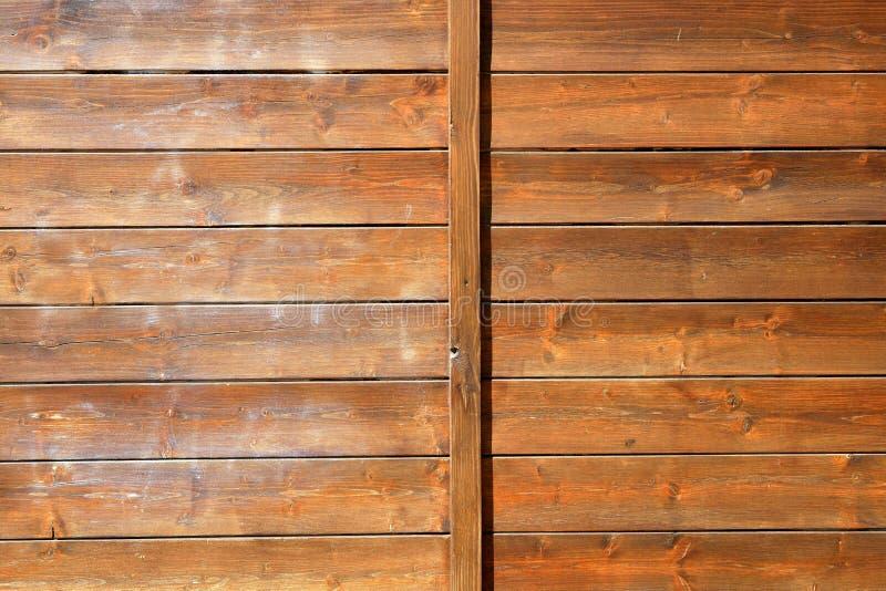 Fondo de madera de oro del modelo de la pared de Brown fotos de archivo