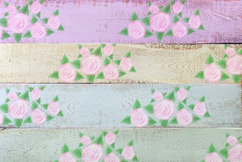Fondo de madera del color en colores pastel con el estampado de flores fotos de archivo