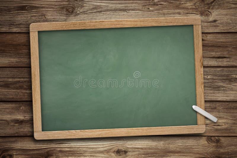 Fondo de madera de la pizarra verde en blanco de la pizarra imagen de archivo