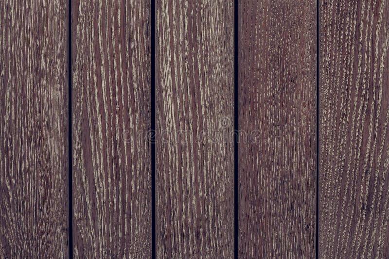 Fondo de madera de la textura del marr?n oscuro Cerca de madera del marr?n oscuro Primer oscuro de los tableros de madera Modelo  foto de archivo