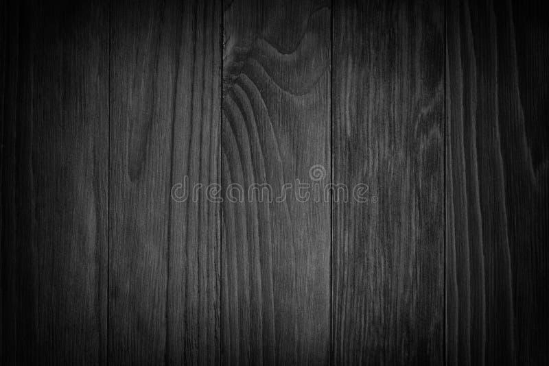 Fondo de madera negro o textura de madera melancólica del grano fotos de archivo