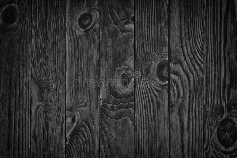 Fondo de madera negro o textura de madera melancólica del grano imagenes de archivo