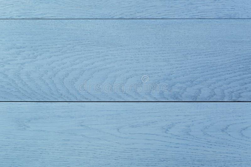 Fondo de madera pintado azul de la tabla foto de archivo