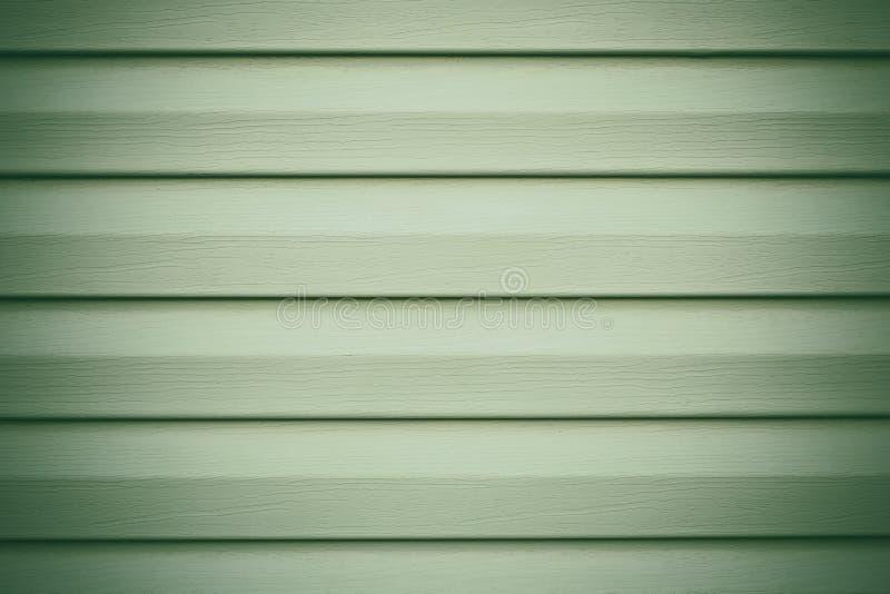 Fondo de madera verde claro en líneas Textura rayada Contexto de la madera de los tablones El panel gris, superficie de madera El imagen de archivo libre de regalías