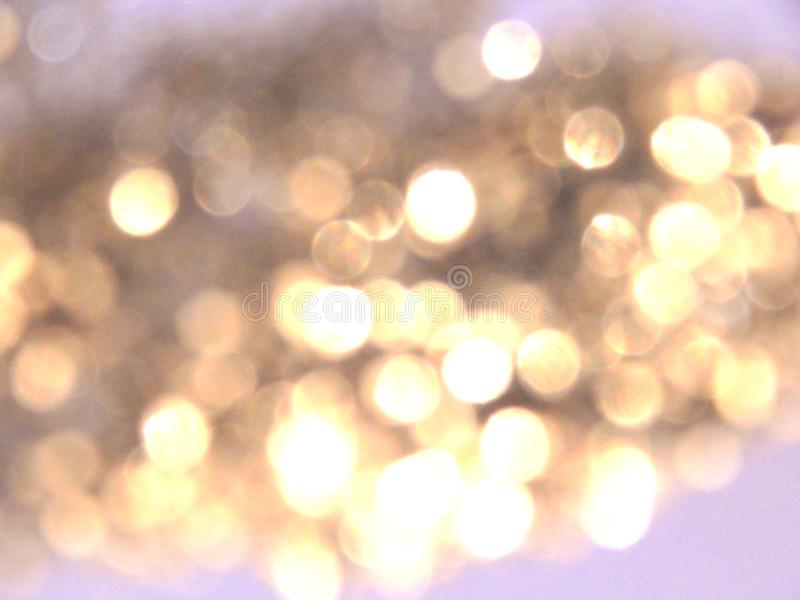Fondo de oro borroso hermoso, luz festiva del bokeh fotos de archivo