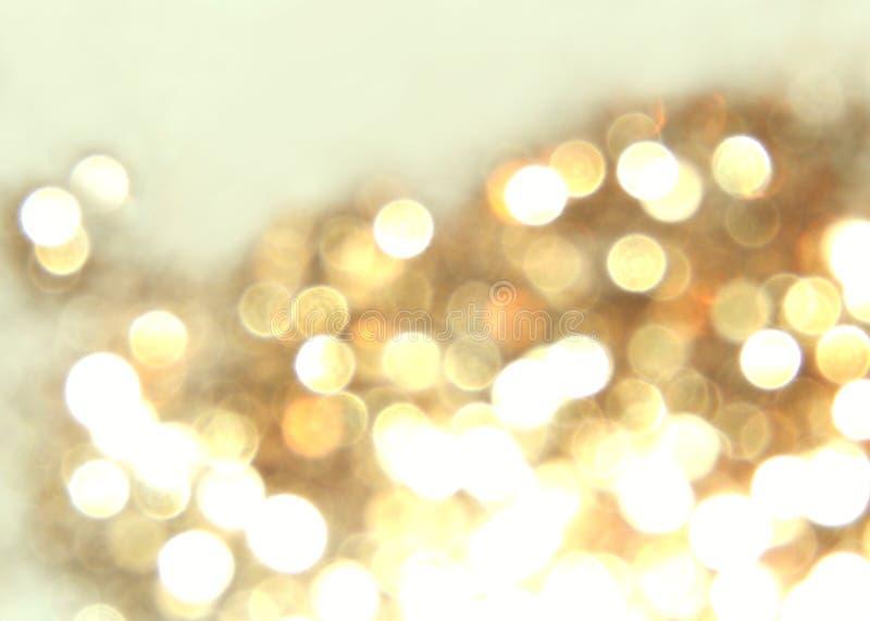 Fondo de oro borroso hermoso, luz festiva del bokeh imagen de archivo libre de regalías