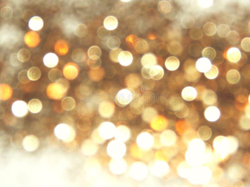 Fondo de oro borroso hermoso, luz festiva del bokeh fotos de archivo libres de regalías
