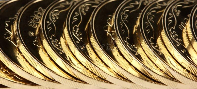 Fondo de oro de las monedas imagenes de archivo