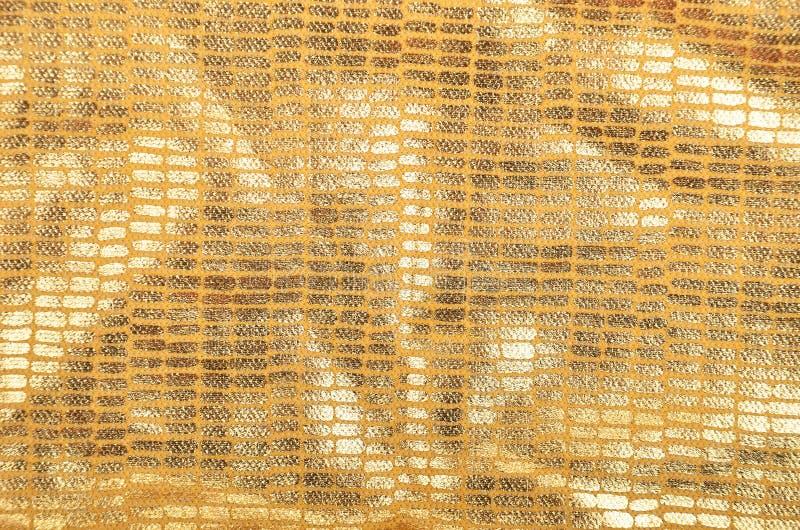Fondo de oro del brocado fotografía de archivo libre de regalías