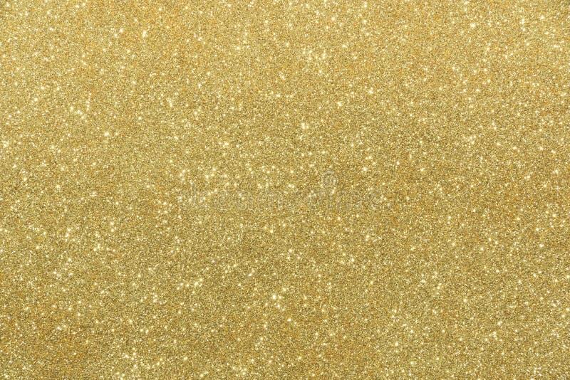 Fondo de oro del extracto de la textura del brillo fotografía de archivo libre de regalías
