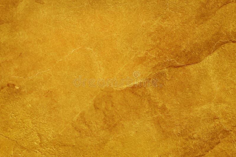 Fondo de oro de la textura del muro de cemento del cemento del color, detalle del estuco ?spero y viejo extracto del grunge para  imagen de archivo