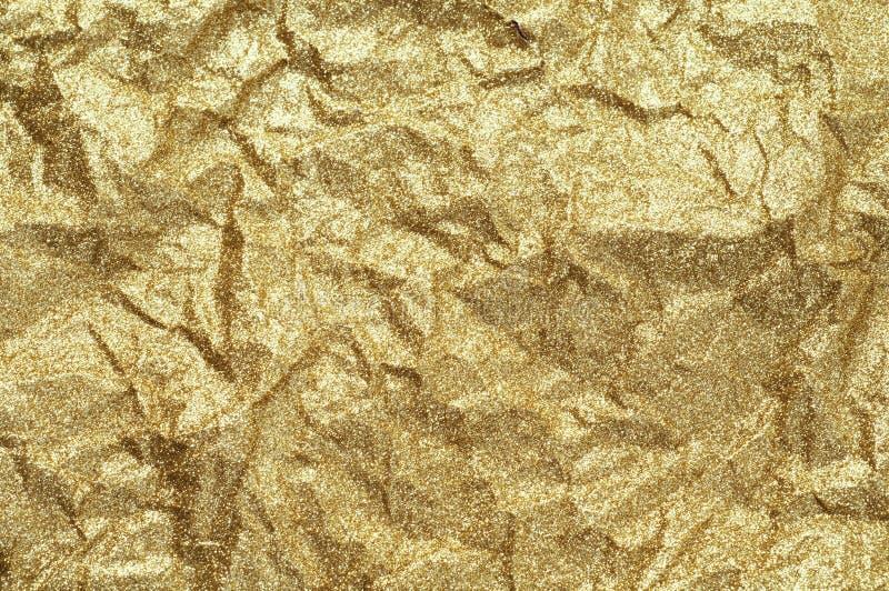 Fondo de papel arrugado oro del extracto de la textura fotos de archivo