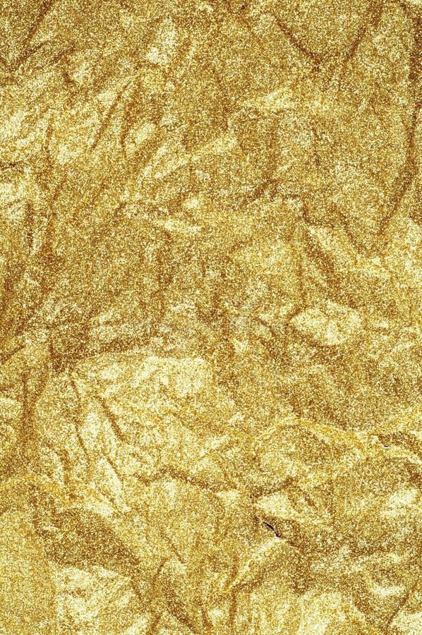Fondo de papel arrugado oro del extracto de la textura foto de archivo