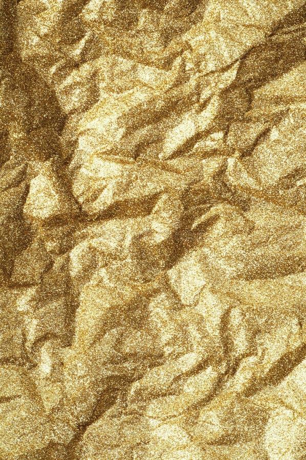 Fondo de papel arrugado oro del extracto de la textura imagenes de archivo