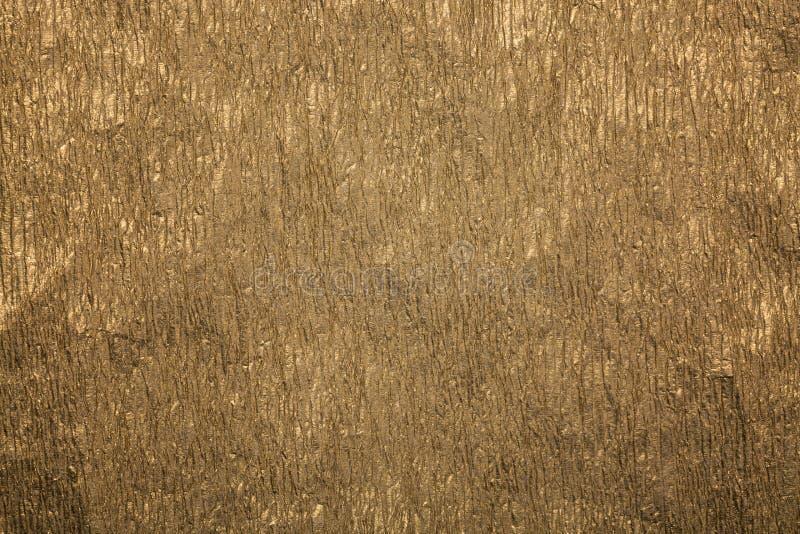 Fondo de papel arrugado oro del extracto de la textura Textura del papel del oro fotos de archivo