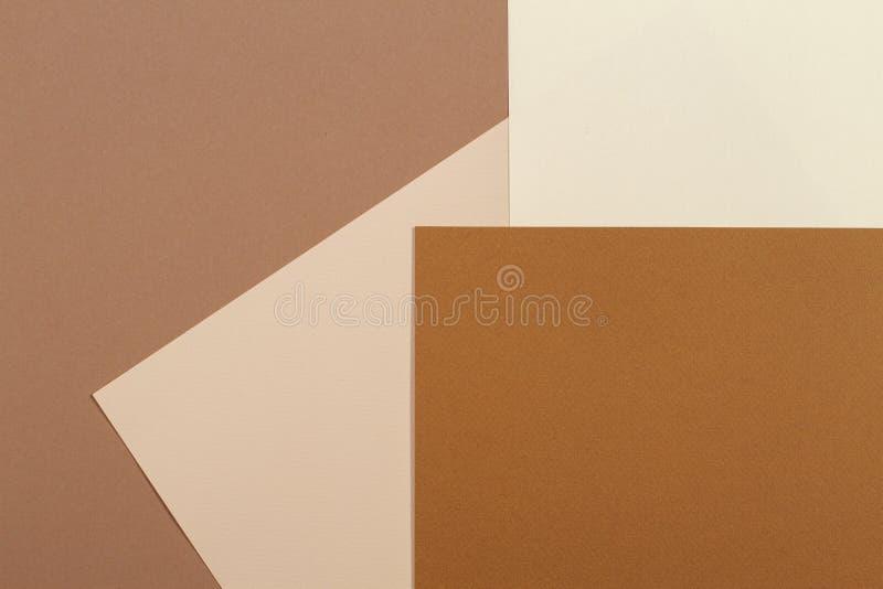 Fondo de papel geométrico abstracto de la cartulina de la textura Beige, colores de moda en colores pastel amarillos del marrón imágenes de archivo libres de regalías