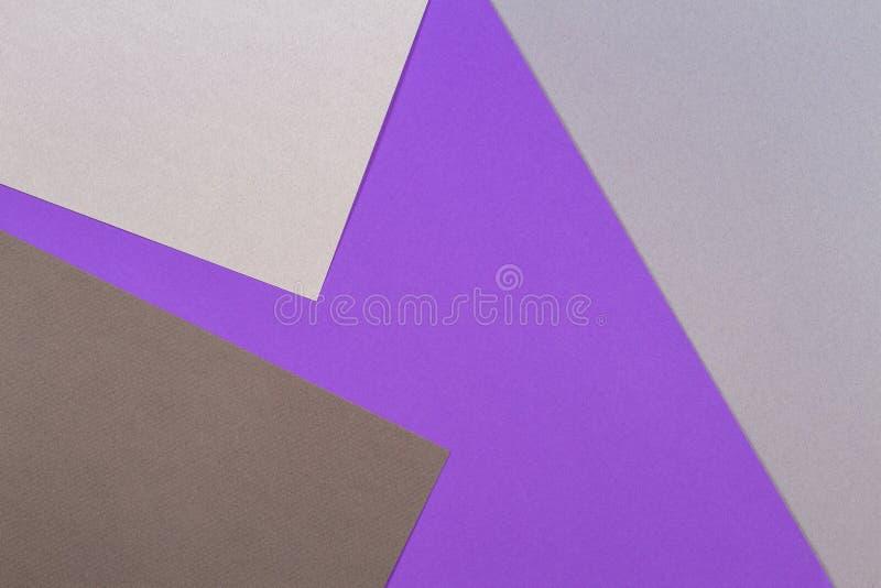 Fondo de papel geométrico abstracto de la cartulina de la textura La vista superior de la tendencia gris violeta púrpura colorea  fotos de archivo