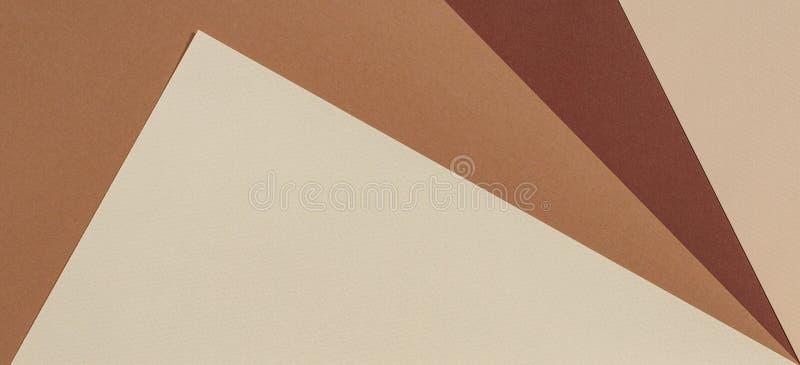 Fondo de papel geométrico abstracto de la textura Beige, colores de moda en colores pastel amarillos del marrón fotos de archivo libres de regalías