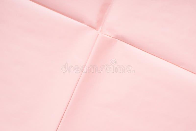 Fondo de papel rosado con textura del pliegue imagenes de archivo