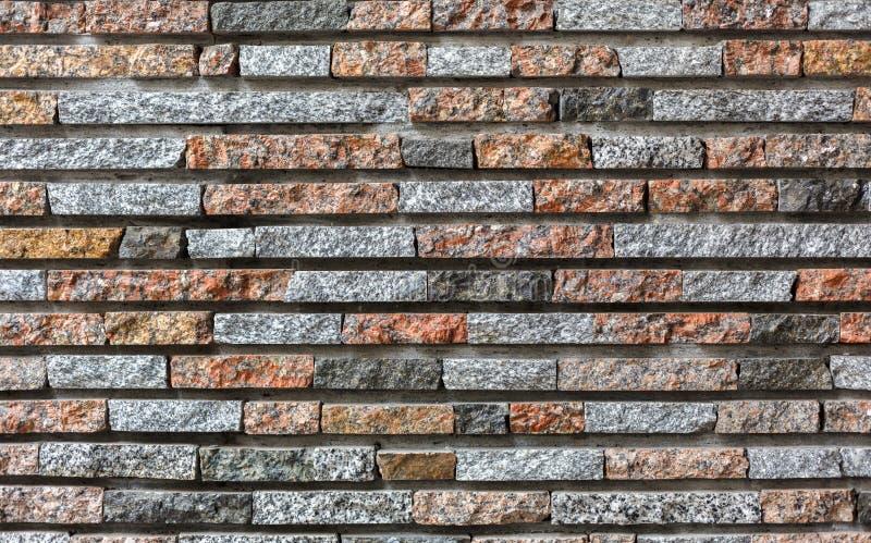 Fondo de piedra coloreado decorativo moderno de la pared de ladrillo fotos de archivo