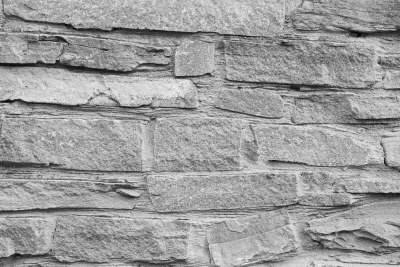 Fondo de piedra gris detallado del ladrillo del alto, textura Pared de piedra gris imagenes de archivo