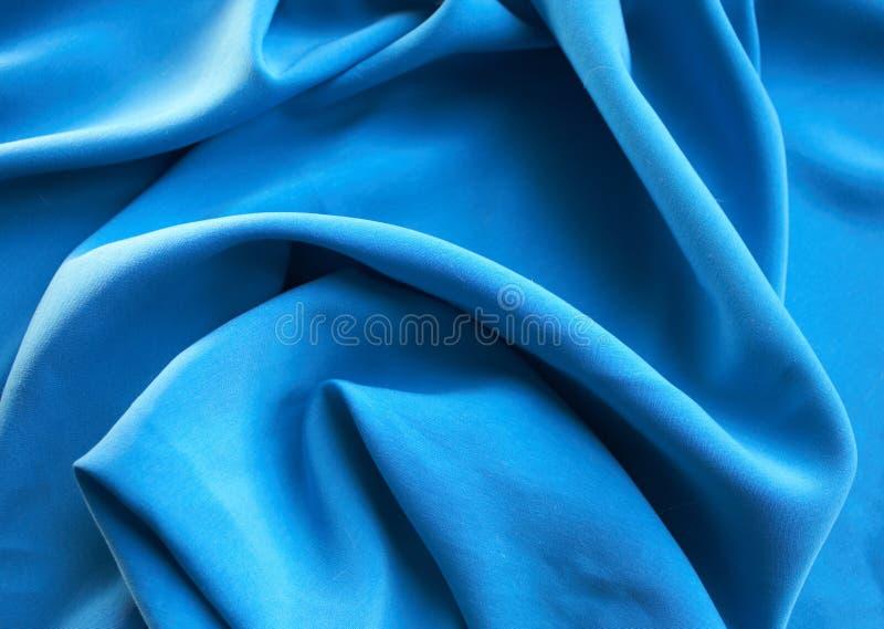 Fondo de seda azul imagenes de archivo
