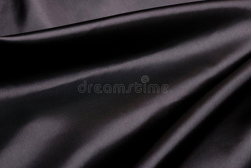 Fondo de seda negro. imagen de archivo libre de regalías