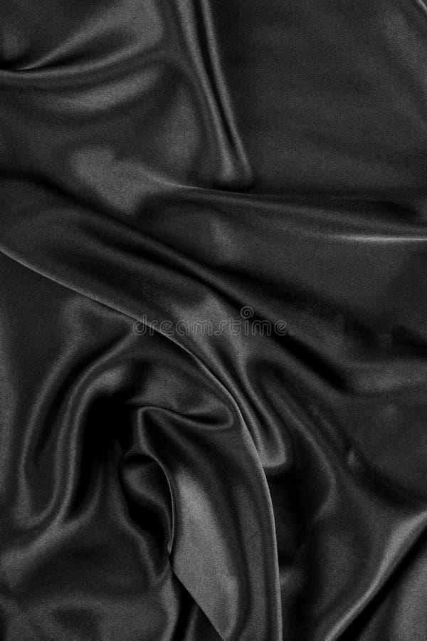 Fondo de seda negro del satén foto de archivo libre de regalías