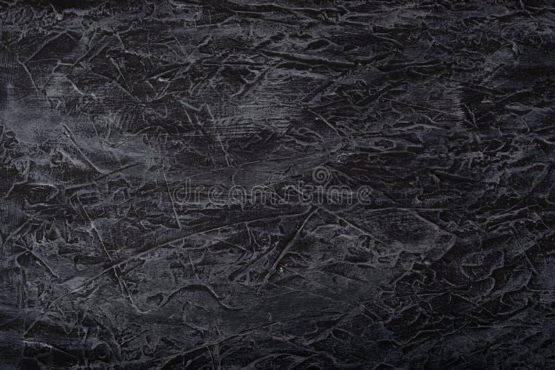 fondo de textura de hormigón con cavidades peculiares y partes huecas pintadas en tonos negros, blancos y grises fotografía de archivo