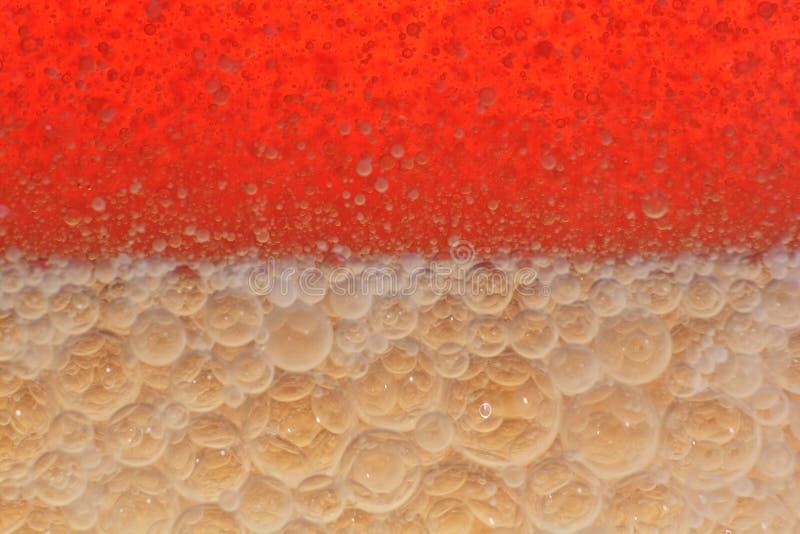 Fondo decorativo del aceite de oliva en el agua. foto de archivo libre de regalías